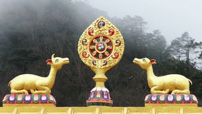 Dharma Wheel Tengboche Buddhist Temple Monastery Khumbu Everest 4k. One of the most important symbols of Buddhism - Dharma Wheel on the background of the foggy stock footage