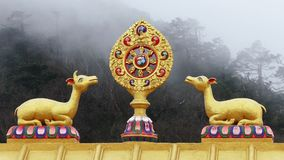 Dharma Wheel Tengboche Clouds Foggy Buddhist Temple Khumbu Nepal Himalayas 4k. One of the most important symbols of Buddhism - Dharma Wheel on the background of stock video footage