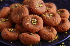 Indian milk based sweet- dharwad peda. Dharwad peda or brown peda is a quick milk based dessert made during Janamashtami festival and offered to Lord Krishna as Stock Image