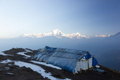 Dhaulagiri massif. In the himalayas with shack in foreground, taken from Khopra, Nepal royalty free stock photos