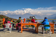 Dhaulagiri mountain from Gorepani village. GOREPANI, NEPAL - APRIL 10, 2016 : Trekkers chill out and see Dhaulagiri mountain from viewpoint at Gorepani village stock photo
