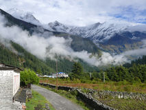 Dhaulagiri range in the clouds from Kalapani. Annapurna circuit, Kali Gandaki river valley, Nepal royalty free stock photo