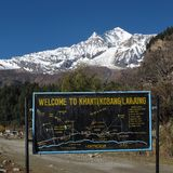 Dhaulagiri and signboard. Seventh highest peak in the world and signboard with trekking routes royalty free stock photos