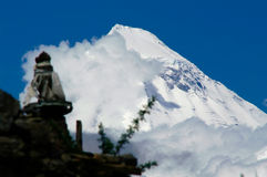 Dhaulagiri. Towering over the monastery of Muktinath royalty free stock photos