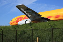 DHL Airbus taxiing. A DHL Airbus A-300 is taxiing on an elevated taxiway towards the runway royalty free stock photo