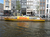 DHL courier boat in Amsterdam Royalty Free Stock Photography