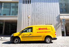 DHL delivery car during service Stock Images