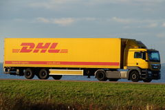 DHL delivery truck at dusk Royalty Free Stock Image