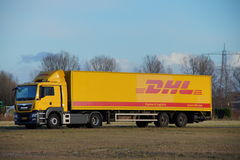 DHL delivery truck parked at dusk Stock Photo