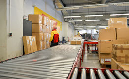 DHL delivery worker cheking package boxes Stock Photo
