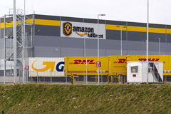 DHL and GLS shipping containers in front of Amazon logistics building on March 12, 2017 in Dobroviz, Czech republic Royalty Free Stock Images