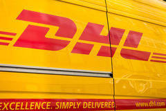 DHL logistic company sign on the delivery van at day time Royalty Free Stock Image