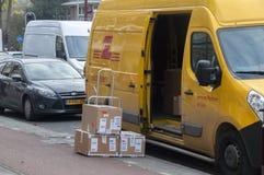 DHL Package Company Van At Amsterdam The Netherlands 2018 immagini stock libere da diritti