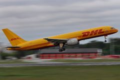 DHL Plane. DHL, a part of Deutsche Post, provides international express mail services. It's air division operates circa 80 aircraft with the main base in Leipzig Royalty Free Stock Photography
