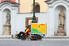 Free DHL Shipping Bicycle With The Crew Man Royalty Free Stock Images - 216892329