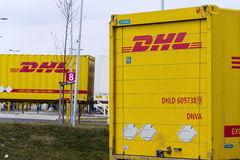 DHL shipping containers in front of Amazon logistics building on March 12, 2017 in Dobroviz, Czech republic. Royalty Free Stock Image