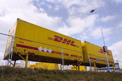 DHL shipping containers in front of Amazon logistics building on March 12, 2017 in Dobroviz, Czech republic. Stock Photos