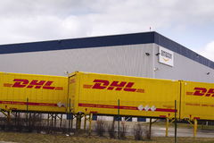 DHL shipping containers in front of Amazon logistics building on March 12, 2017 in Dobroviz, Czech republic. Stock Image