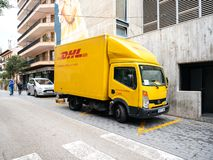DHL truck delivering post parcels on the in central INCA. INCA, PALMA DE MALLORCA, SPAIN - MAY 8, 2018: DHL truck delivering post parcels on the in central INCA royalty free stock photo