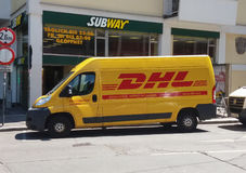 DHL van on the street Stock Images