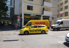 DHL van and taxi on the street Royalty Free Stock Photos