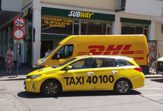 DHL van and taxi on the street Royalty Free Stock Photography