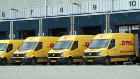 DHL vans befor a loading dock Royalty Free Stock Photography