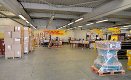 DHL warehouse with package boxes of different size Stock Photo