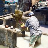 A Dhobi (clothes washer) in Dhobi Ghat, Mumbai India Stock Image