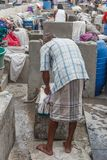 Dhobi Gana is a well known open air laundromat in Chennai India. The washers, locally known as Dhobis, work in the open to wash the clothes from chennai hotels Stock Image