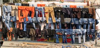 Dhobi Ghat - hanging jeans. Lines of jeans hanging on the line in Dhobi Ghat - an oute laundry in Mumbai Stock Images