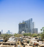 Dhobi Ghat laundry, Mumbai, India. Dhobi Ghat open air laundry in shadow of high rise buildings and skyline of Mumbai, India on sunny day. report at april 2016 Stock Images