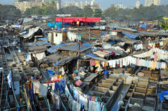 Dhobi Ghat in Mumbai, India. DELHI, INDIA - 5 NOVEMBER, 2009: An unidentified Indian people work at Dhobi Ghat in Mumbai on November 5, 2009. Dhobi Ghat is the Royalty Free Stock Images