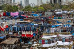 Dhobi Ghat Mumbai Laundry. Dhobi Ghat is a well known open air laundromat in Mumbai, India. The washers, known as dhobis, work in the open to clean clothes and Royalty Free Stock Image