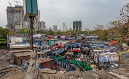 Dhobi Ghat Mumbai Laundry. Dhobi Ghat is a well known open air laundromat in Mumbai, India. The washers, known as dhobis, work in the open to clean clothes and Stock Image