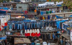 Dhobi Ghat Mumbai Laundry. Dhobi Ghat is a well known open air laundromat in Mumbai, India. The washers, known as dhobis, work in the open to clean clothes and Royalty Free Stock Photography
