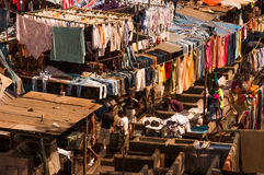 Dhobi Ghat. Is an open air laundromat in Mumbai. Only men work here.They work as father-son teams, sifting through hundreds of clothes to make anywhere from 500 Stock Images
