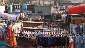 Dhobi Ghat - rows of washing. Lines of jeans hanging on the line in Dhobi Ghat - an outside laundry in Mumbai Stock Photos