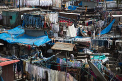 Dhobi Ghat. A unique feature of Mumbai, the dhobi is a traditional laundryman, who will collect your dirty linen, wash it, and return it neatly pressed to you Royalty Free Stock Image