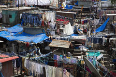 Dhobi Ghat. A unique feature of Mumbai, the dhobi is a traditional laundryman, who will collect your dirty linen, wash it, and return it neatly pressed to you Royalty Free Stock Photos