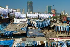 Dhobi Ghat, the world's largest outdoor laundry. MUMBAI - 12 DECEMBER 2012: People at Dhobi Ghat, the world's largest outdoor laundry on December 12, 2012 in Stock Photos