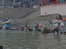 Dhobiwallahs wash clothes in the Ganges River Stock Photo