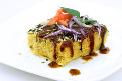 Dhokla,Indian snack. Famous Indian snack Dhokla on white background Stock Image