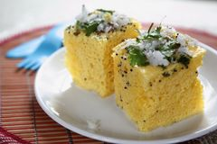 Dhokla, Steamed cake. Dhokla is a traditional Gujarati snack that is served for festive meals. Rice and Urad dal are the main ingredients. Although dhoklas taste stock photos