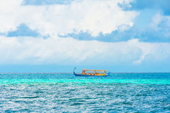 Dhoni boat in the ocean. In a sunny day Stock Photography
