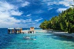 Dhoni boats at jetty. Of a paradisiac maldivian island Stock Images