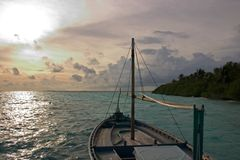 Dhoni in Sunset. Traditionally maldivian Dhoni in Sunset, Indian Ocean, Maldives Royalty Free Stock Photo