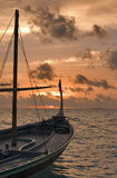 Dhoni in Sunset. Traditionally maldivian Dhoni in Sunset, Indian Ocean, Maldives Stock Image