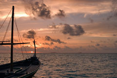 Dhoni in Sunset. Traditional maldivian dhoni in the sunset Royalty Free Stock Image