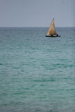 Dhow on blue water Royalty Free Stock Photos